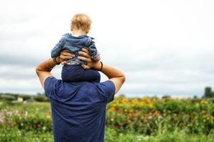 baby-sitting-on-man-s-shoulder-1497394
